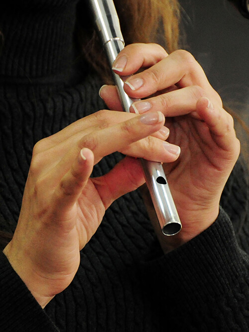 woman playing irish tin whistle